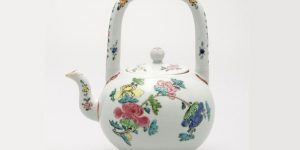 Teapot with lid. Porcelain with famille rose enamel decoration of flowering branches of peony, rose and chrysanthemum and flowers. China, Jiangxi province, Jingdezhen. Qing dynasty, AD 18th c. Height 15.8 cm. Donated by George Eumorfopoulos (GE 2874)